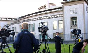 Journalists gather outside the international war crimes tribunal