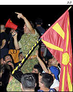 Macedonian army soldiers and civilians protest against the peace deal