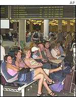 Tourists wait at airport
