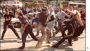 A group of attackers clash with Serbian police