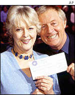 UK Millionaire winner Judith Keppel and host Chris Tarrant