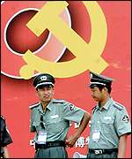 Chinese policemen watch over the crowd on Tiananmen Square