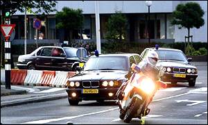 Milosevic convoy drives through The Hague from prison to UN court