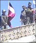 Georgian troops fly the flag at Vaziani