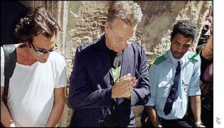 Manzarek [centre] prays at the grave