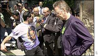 Bodyguards prevent a fan from approaching former Doors keyboardist Ray Manzarek