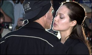 Actress Angelina Jolie and husband Billy Bob Thornton share a kiss outside the Empire