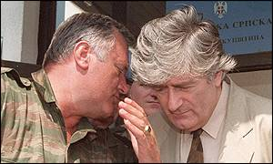 Former Bosnian Serb military commander Ratko Mladic and president Radovan Karadzic confer in a 1993 file photo