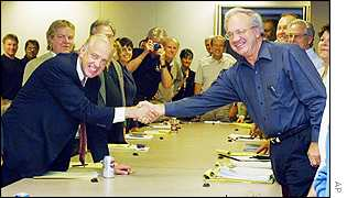 Brian Walton, chief negotiator for the Screen Actors Guild, left, shakes hands with Nick Counter, president and chief negotiator for the Alliance of Motion Picture and Television Producers