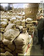 People observe bags of Stasi files