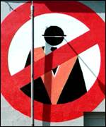 A no-entry styled sign with the figure of an Orangeman on the end of a Catholic home in Belfast
