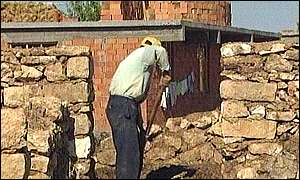 Villager rebuilds house