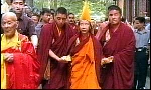 The Panchen Lama is led through the streets of Shanghai