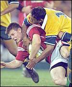 Brian O'Driscoll tackled by Andrew Walker