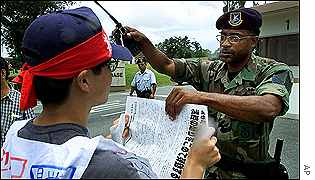 An Okinawan student is asked by a US serviceman to leave from Kadena Air base