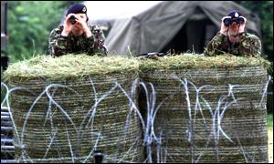 Soldiers keep watch on the barricaded Drumcree Bridge
