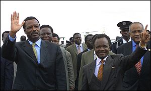 Zambian President Frederick Chiluba (right) and President Pierre Buyoya of Burundi at Lusaka airport