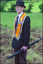 A bowler-hatted Orangeman at Drumcree