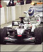 Mika Hakkinen is given a lift back to the pits by David Coulthard at the Spanish Grand Prix