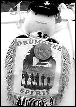 A Drumcree doll on a drum at Rosnowlagh