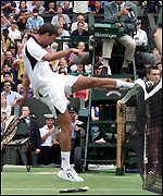 Goran Ivanisevic kicks the net in frustration