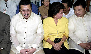 Mr Estrada (l) with his wife Luisa Ejercito and son Jinggoy