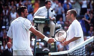 Andre Agassi congratulates Pat Rafter after their semi-final match