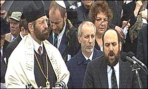 Jewish clergy preside over the prayers
