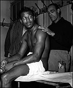 Sugar Ray Robinson on the massage table