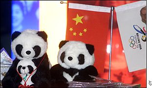Toy pandas placed near a Chinese flag at the IOC meeting in Moscow