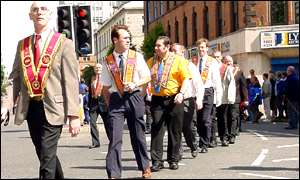 Orangemen walking past Ormeau Avenue in Belfast