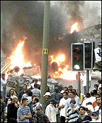 Smoke billows from behind a blockade in Bradford on 7 July 2001