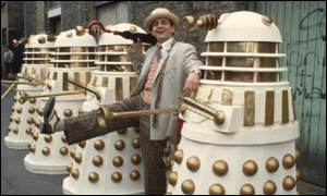 Sylvester McCoy finds time to joke with the most famous of all the Doctor's enemies, the Daleks