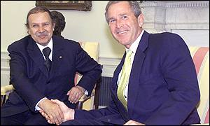 Algerian President Abdelazziz Bouteflika shakes hands with US President George W Bush in Washington on Thursday