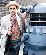 Sylvester McCoy gets friendly with a dalek enermy in the TV series