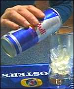 A can of red Bull being poured