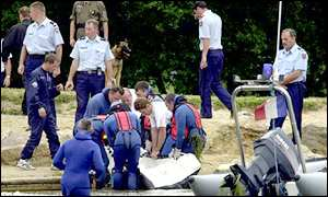 police divers recovering body