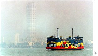 A ferry cruises from the Malaysian mainland to Penang island, with a view of the haze in the background