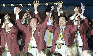 Members of the Beijing delegation celebrate as IOC President Juan Antonio Samaranch announced that China will host the 2008 Olympics