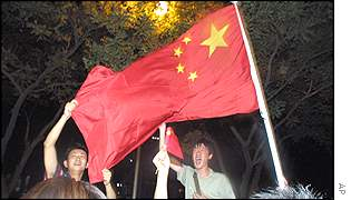 Celebrating Chinese men wave flags in Beijing