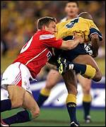 Jonny Wilkinson tackles George Gregan