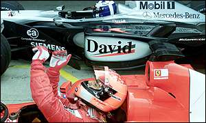Michael Schumacher celebrates pole