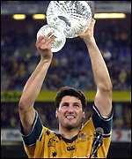 John Eales lifts the trophy