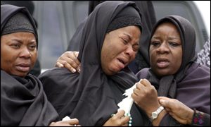 Bunmi's mother, Salimata Shagaya, is comforted ahead of the funeral service