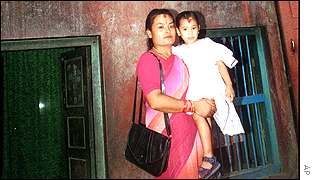 Preeti Shakya being carried by her mother Reena Shakya