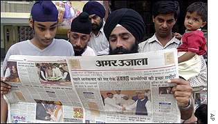 Indians reading local newspaper