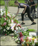 Residents of Gonesse lay flowers at the crash site