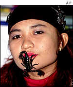 Nor Malena Hassan with scorpion on her face