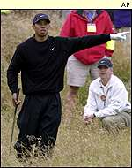 Tiger Woods takes a look from the rough