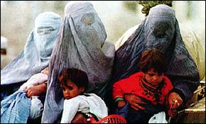 Afghan women wearing the veil with children